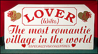 BNPS.co.uk (01202 558833)<br /> Pic: TomWren/BNPS<br /> <br /> An old sign from the post office.<br /> <br /> A British village is cashing in on the cupid effect this Valentine's Day by launching its own postal service so anyone can send a card from the 'world's most romantic village'.<br /> <br /> The tiny village of Lover in Wiltshire has launched the 'Lover Post' with limited edition cards and a special post mark showing it has been sent from the tender-hearted village.<br /> <br /> The quirky gimmick is part of a campaign to save the once-thriving village for the local community.