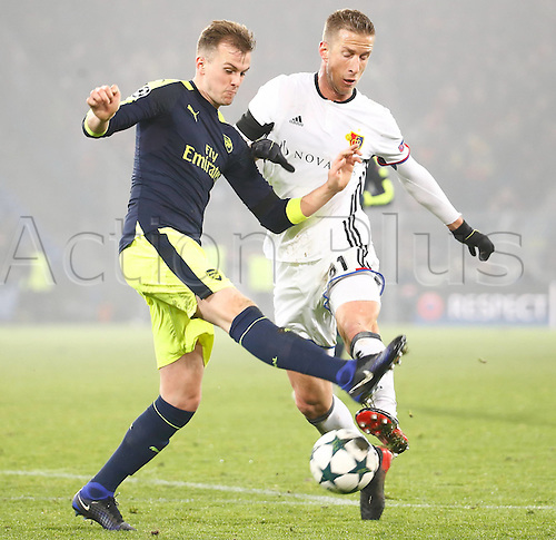 06.12.2016. Basel, Switzerland. Champions League Group A FC Basle versus Arsenal at St. Jakob Park.   Rob Holding (Arsenal) challenges Marc Janko (FC Basel)