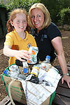 Pupils from Radyr Primary School visititing Welsh Water Education Centre in Cilfynydd..Amy Healey with teacher Sharon Phillips learning about recycling..24.05.12.©Steve Pope