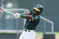 Oakland Athletics outfielder Lawrence Butler (14) swings at a pitch during an exhibition game against Team Italy at Lew Wolff Training Complex on October 3, 2018 in Mesa, Arizona. (Zachary Lucy/Four Seam Images)