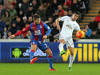 (L-R) Yohan Cabaye of Crystal Palace is challenged by Jack Cork of Swansea during the Barclays Premier League match between Swansea City and Crystal Palace at the Liberty Stadium, Swansea on February 06 2016