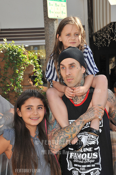 "Blink 182 star Travis Barker & kids at the Los Angeles premiere of ""Puss in Boots"" at the Regency Village Theatre, Westwood..October 23, 2011  Los Angeles, CA.Picture: Paul Smith / Featureflash"