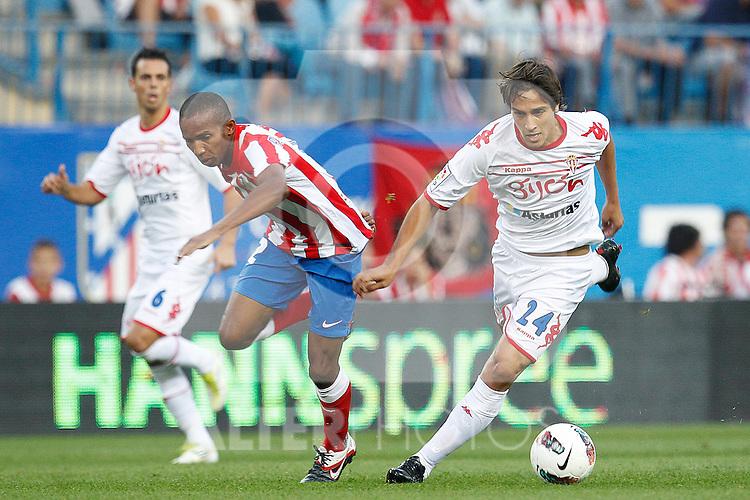 Atletico de Madrid's Pablo Assuncao and Sporting de Gijon's Trejo during la Liga match on september 21st, 2011..Photo: Cesar Cebolla / ALFAQUI