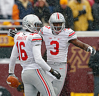 Ohio State Buckeyes quarterback J.T. Barrett (16) celebrates his touchdown with Ohio State Buckeyes wide receiver Michael Thomas (3) against Minnesota Golden Gophers defense during the 1st quarter at TCF Bank Stadium in Minneapolis, Minn. on November 15, 2014.  (Dispatch photo by Kyle Robertson)