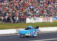 Jun 11, 2017; Englishtown , NJ, USA; NHRA funny car driver John Force does a wheelstand during the Summernationals at Old Bridge Township Raceway Park. Mandatory Credit: Mark J. Rebilas-USA TODAY Sports