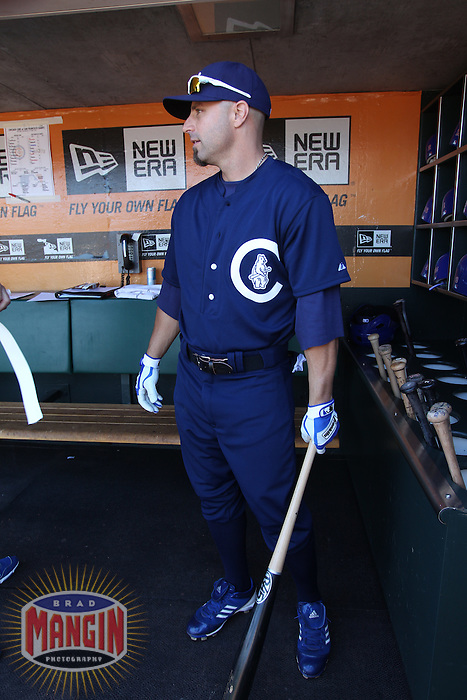 SAN FRANCISCO, CA - JUNE 2:  Reed Johnson #5 of the Chicago Cubs gets ready in the dugout before the game against the San Francisco Giants at AT&T Park on Saturday, June 2, 2012 in San Francisco, California. Photo by Brad Mangin