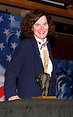 "Comic Paula Poundstone poses with the ""Equine Posterior Award"" she accepted in absentia for United States Representative Ernie Istook (Republican of Oklahoma), by Norman Lear's liberal advocacy group, People for the American Way for sponsoring the Religious Freedom Amendment to the Constitution in Washington, D.C. on May 18, 1998.  The award was designed by artist Robert Rauschenberg and cast by Robert Graham (Anjelica Huston's husband, not the Senator from Florida)..Credit: Ron Sachs / CNP"