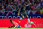 Lionel Jules Carole of Sevilla FC jumps to avoid Jorge Resurreccion Merodio, Koke, of Atletico de Madrid during the La Liga 2017-18 match between Atletico de Madrid and Sevilla FC at the Wanda Metropolitano on 23 September 2017 in Wanda Metropolitano, Madrid, Spain. Photo by Diego Gonzalez / Power Sport Images