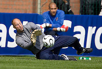 USA's Kasey Keller stops a shot while Tim Howard watches during practice in Hamburg, Germany, for the 2006 World Cup, June, 9, 2006.