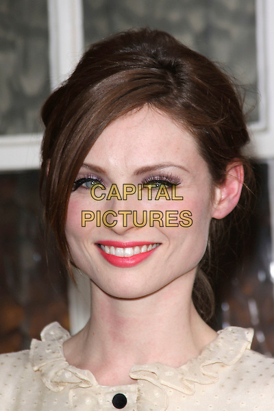 SOPHIE ELLIS BEXTOR .attending the Women For Women Gala, Banqueting House, London, England, UK, May 5th 2011..portrait headshot make-up pink lipstick false eyelashes beauty cream white blouse buttons ruffle neck smiling .CAP/AH.©Adam Houghton/Capital Pictures.