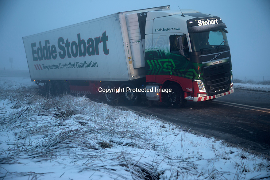 14/01/16<br /> <br /> The A54 Cat and Fiddle road is closed after an Eddie Stobart lorry slides off the road in Derbyshire Peak District near Buxton.<br /> <br /> All Rights Reserved: F Stop Press Ltd. +44(0)1335 418365   +44 (0)7765 242650 www.fstoppress.com