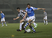 Frazer Wright being pressured by John McGinn in the St Mirren v St Johnstone Clydesdale Bank Scottish Premier League match played at St Mirren Park, Paisley on 8.12.12.
