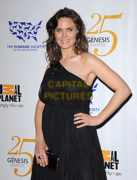 EMILY DESCHANEL .at The Humane Society of The United States celebration of The 25th Anniversary Genesis Awards in Beverly Hills, California, USA, .March 19th 2011..half length dress hand on hip clutch bag black one shoulder                         .CAP/RKE/DVS.©DVS/RockinExposures/Capital Pictures.