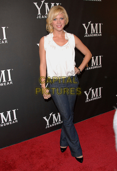 BRITTANY SNOW.attends The 4th Annual YMI Jeanswear Fashion Show held at Boulevard3 in Hollywood, LA, California, USA,.October 09 2007.   .full length white sleeveless top dark indigo flared jeans black shoes hand on hip.CAP/DVS                                       .©Debbie VanStory/Capital Pictures