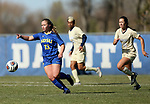 BROOKINGS, SD, OCTOBER 21: Madison Chapman #13 from South Dakota State directs teammates in front of Brianna McGowan #18 from Oral Roberts during their match Sunday afternoon at Fischback Soccer Field in Brookings. (Dave Eggen/Inertia)