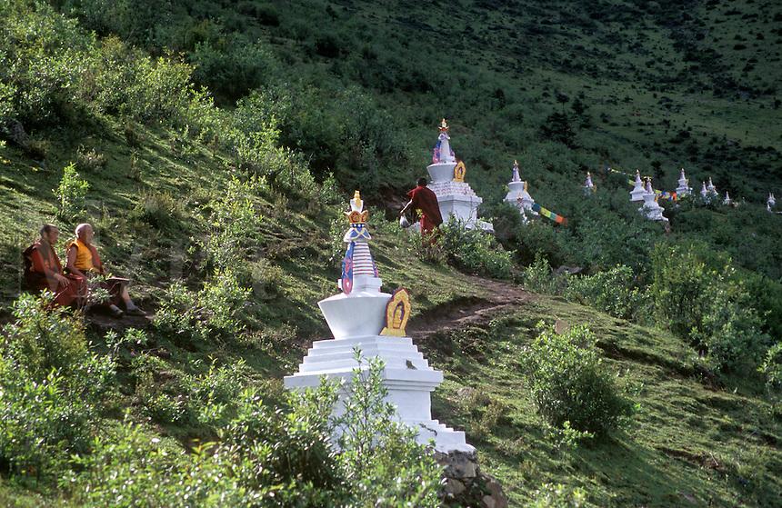 Stupas & monks above the Tibetan Buddhist monastery of Katok Dorjeden - Kham, (E. Tibet), Sichuan Province, China