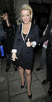 """SHERIDAN SMITH .Departed after the first preview performance of """"Flare Path"""", Haymarket, London, England, UK, 4th March 2011..full length black dress white sleeves trim shoes coat hand thumb up gesture jacket blazer dress .CAP/CAN.©Can Nguyen/Capital Pictures."""