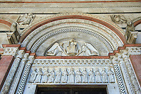 Late medieval relief sculptures of the typanuim of the main door depicting the Christ Pantocrator above the Apostles , the Cattedrale di San Martino,  Duomo of Lucca, Tunscany, Italy,