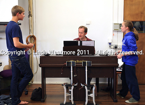"The fawn, ""Mr Tumnus"", and ""Lucy"" with Musical Director, David Perkins.  The Yvonne Arnaud Youth Theatre rehearsing ""The Lion, the Witch and the Wardrobe"", Guildford, Surrey."