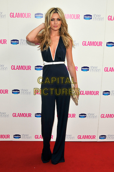ABIGAIL CLANCY .Glamour Women Of The Year Awards - Inside Arrivals, Berkeley Square Gardens, London, England, UK, .June 8th 2010..full length abi abbey abby navy blue catsuit jumpsuit halterneck plunging neckline hand touching hair white trim belt .CAP/PL.©Phil Loftus/Capital Pictures.