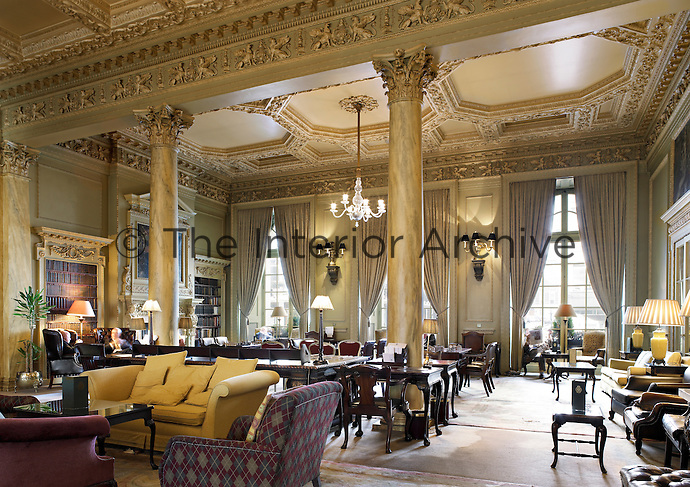 The interior of the London's Royal Automobile Club. Despite its monumental interior architecture and ornate decoration, the smoking room is reserved for informal activities such as enjoying tea and light meals and playing cards or backgammon.