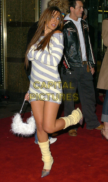 "JODIE MARSH.""Get Rich Or Die Tryin'"" UK film premiere at Empire ELicester Square, London, UK..January 17th, 2006.Ref: CAN.full length leg in air grey gray yellow stripes striped leg warmers mouth open furry feather purse white.www.capitalpictures.com.sales@capitalpictures.com.©Capital Pictures"