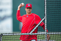 Lakewood BlueClaws pitching coach Brian Sweeney (10) throws batting practice prior to the game against the Kannapolis Intimidators at Kannapolis Intimidators Stadium on April 6, 2017 in Kannapolis, North Carolina.  The BlueClaws defeated the Intimidators 7-5.  (Brian Westerholt/Four Seam Images)