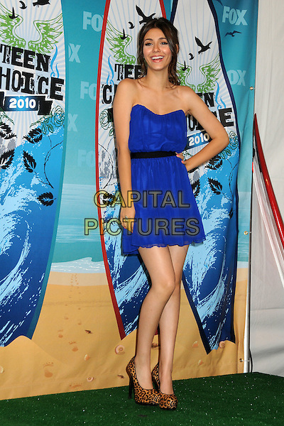 VICTORIA JUSTICE .Teen Choice Awards 2010 - Press Room held at Universal Studios Gibson Amphitheatre, Universal City, California, USA, 8th  August 2010..full length blue strapless dress hand on hip leopard print brown shoes animal heels .CAP/ADM/BP.©Byron Purvis/AdMedia/Capital Pictures.