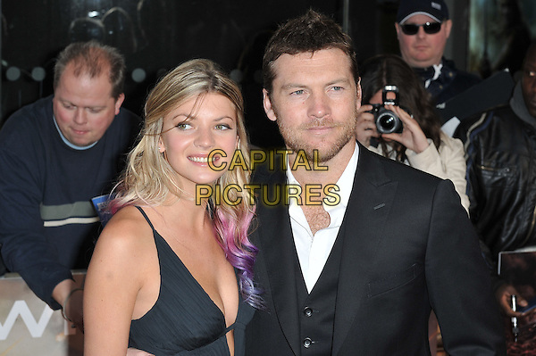 Crystal Humphries & Sam Worthington.'Wrath Of The Titans' European Premiere at The BFI IMAX, London, England..29th March 2012.headshot portrait black white shirt stubble facial hair couple.CAP/MAR.© Martin Harris/Capital Pictures.