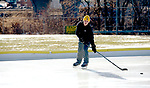 NAUGATUCK, CT-122717JS07----Brian Parzyck, 16, of Naugatuck braved Thursday's freezing temperatures and works on his hockey skills at the town ice rink at Breen Field in Naugatuck. The rink opened for the season on Thursday. <br />  Jim Shannon Republican-American