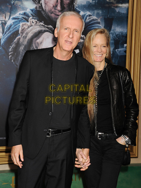 HOLLYWOOD, CA - DECEMBER 09: Director James Cameron (L) and wife Suzy Amis arrive at the 'The Hobbit: The Battle Of The Five Armies' at Dolby Theatre on December 9, 2014 in Hollywood, California.<br /> CAP/ROT/TM<br /> &copy;TM/ROT/Capital Pictures