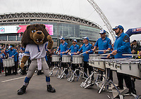 26.10.2014.  London, England.  NFL International Series. Atlanta Falcons versus Detroit Lions. Lions drum band with the Lions Mascot outside Wembley Stadium.