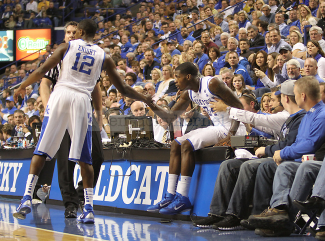Brandon Knight helped teammate DeAndre Liggins up during the second half of the game against East Tennessee State University at Rupp Arena on Friday, November 12, 2010. Photo by Latara Appleby | Staff