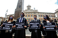 Young lawyers showing banners during the demonstration AIGA, Association of Young Lawyers, in Montecitorio Square, to ask the Government a quick restart of justice activities after the stop due to the Coronavirus pandemic. The banner says Italy restart, justice must restart, citizens 6 months without justice. Rome (Italy) June 11th 2020<br />  <br /> <br /> Photo Samantha Zucchi Insidefoto