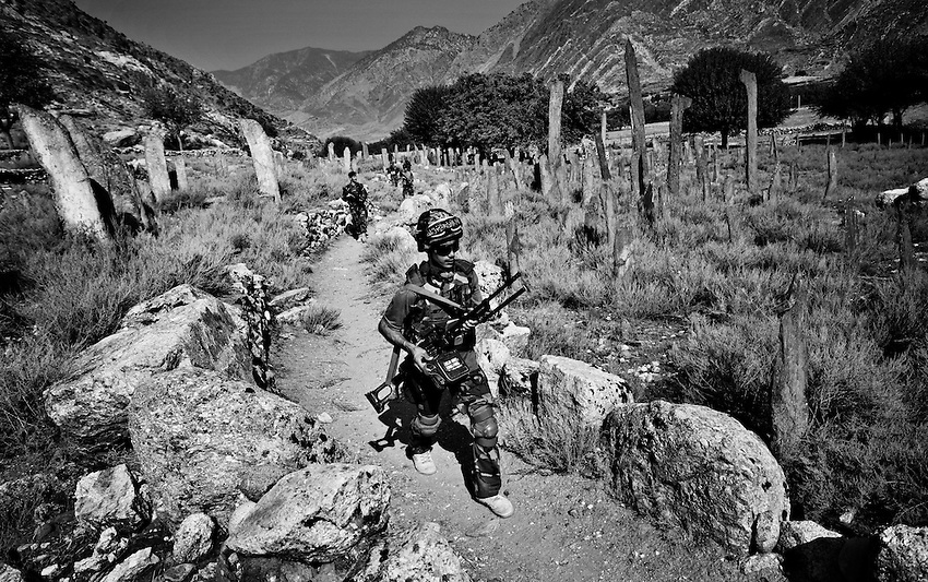 Members of the 4th Marines Embedded Training Team (EET) and the Afghan National Army patrol on foot in the Pesh Valley, Kunar Province, Afghanistan, Saturday, Sept 26, 2009.