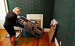 WATERTOWN,  CT-052119JS21- --Linda Merriman, President of the Watertown Historical Society shows off an old Watertown General Store sign from the bicentennial celebration as they move into its new home on Tuesday. <br /> Jim Shannon Republican American