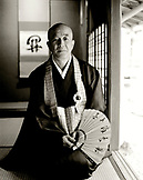 JAPAN, Kyushu, portrait of Hizhidea-Machi holding Japanese fan (B&W)