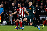 Enda Stevens of Sheffield United and Jonjo Shelvey of Newcastle United during the Premier League match at Bramall Lane, Sheffield. Picture date: 5th December 2019. Picture credit should read: James Wilson/Sportimage