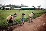 Young children transporting water in Mweso, sept 2013