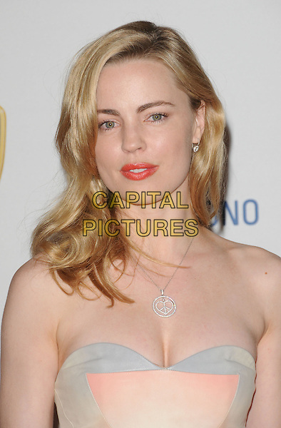 MELISSA GEORGE.The 16th Annual Race to Erase MS - Rock to Erase MS held at The Hyatt Regency Century Plaza in Century City, California, USA. .May 8th, 2009.headshot portrait silver peace heart symbol necklace red lipstick cleavage strapless.CAP/DVS.©Debbie VanStory/Capital Pictures.