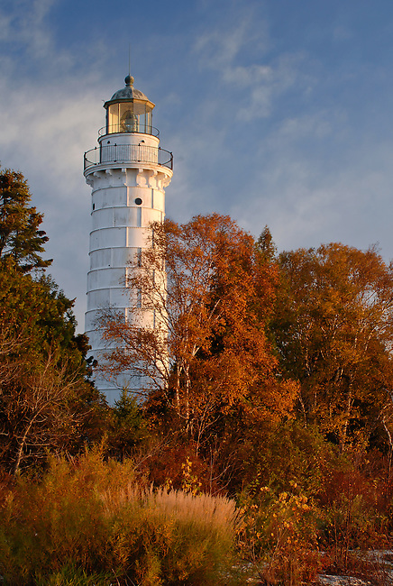 Cana Island Light seems lit by the autumn morning light, while in reality the still active light turns off just prior to sunrise, Door County, Wisconsin