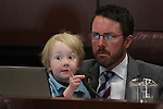 Nevada Assemblyman David Bobzien, D-Reno, sits with his son Luca, 4, during a committee hearing at the Legislative Building in Carson City, Nev., on Monday, March 11, 2013..Photo by Cathleen Allison