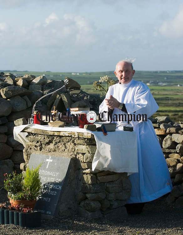 Doonbeg Parish Priest Fr. Joe Haugh celebrates the annual open air mass on a windy July evening at St Senan's Altar, Tullaher, Doonbeg. Photograph by John Kelly.