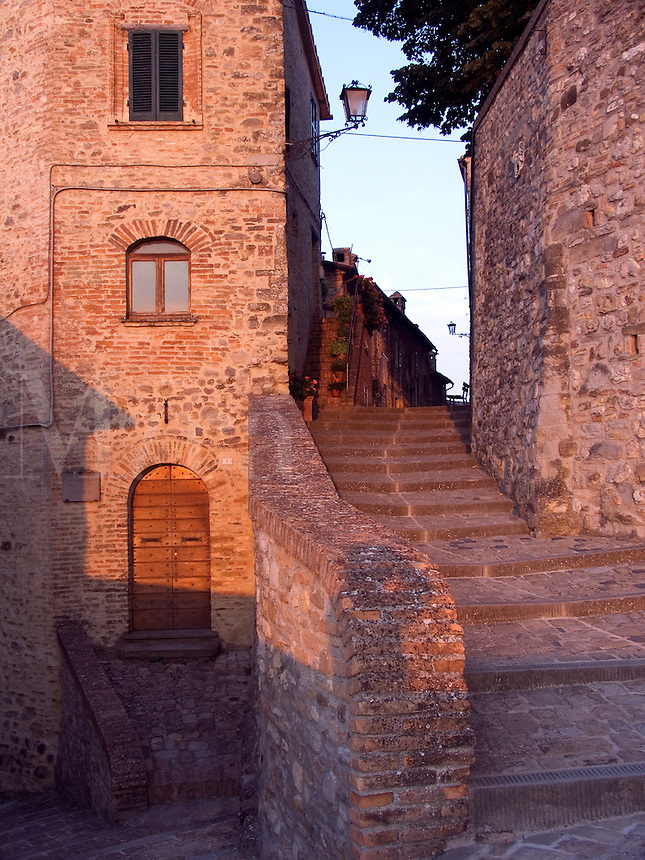 Stone steps lead to upper street level in Montone, Ital