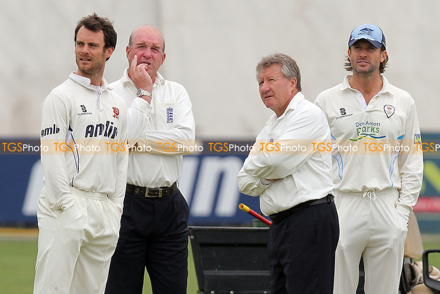 Essex captain James Foster (L) and Derbyshire captain Luke Sutton (R) assess the prospects of play with umpires Nigel Cowley and George Sharp - Essex CCC vs Derbyshire CCC - LV County Championship Division Two Cricket at the Ford County Ground, Chelmsford - 24/08/11 - MANDATORY CREDIT: Gavin Ellis/TGSPHOTO - Self billing applies where appropriate - Tel: 0845 094 6026