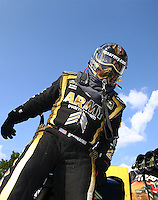Sep 5, 2016; Clermont, IN, USA; NHRA top fuel driver Tony Schumacher climbs from his dragster after winning the US Nationals at Lucas Oil Raceway. Mandatory Credit: Mark J. Rebilas-USA TODAY Sports