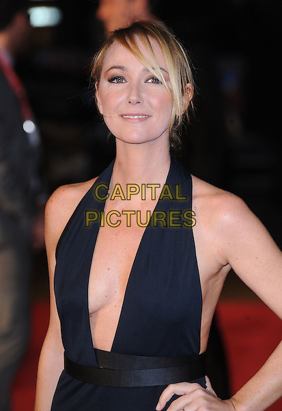 "FRIDA GIANNINI.Attending The European Premiere of ""127 Hours"" during the closing gala of the 54th BFI London Film Festival, Odeon Leicester Square, London..28th October 2010.LFF half length Gucci black low cut halterneck dress plunging neckline  sandals hand on hip .CAP/BEL.©Tom Belcher/Capital Pictures."