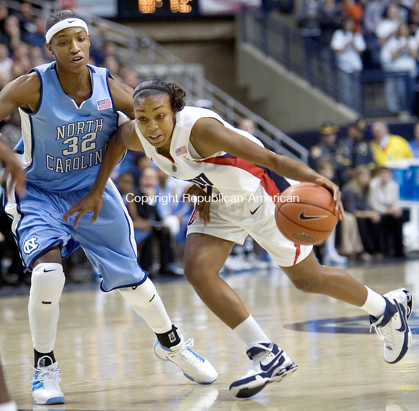 STORRS, CT. 21 January 2008-012108SV06--#20 Renee Montgomery of UConn drives past #32 Rashanda McCants of North Carolina at Gampel Pavilion in Storrs Monday.<br /> Steven Valenti Republican-American