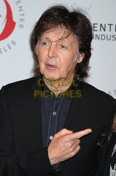 Sir Paul McCartney<br /> at The Shakespeare Center of Los Angeles' 23rd Annual Simply Shakespeare held at The Broad Stage, Santa Monica, California, USA, 25th September 2013.<br /> portrait headshot  black blue navy suit shirt hand finger pointing <br /> CAP/ADM/RE<br /> &copy;Russ Elliot/AdMedia/Capital Pictures