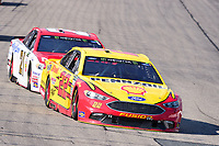 July 16, 2017 - Loudon, New Hampshire, U.S. - Joey Logano, Monster Energy NASCAR Cup Series driver of the Shell Pennzoil Ford (22),leads Ryan Blaney,driver of the Motorcraft / Quick Lane Tire & Auto Center Ford (21), into turn 1 at the NASCAR Monster Energy Overton's 301 race held at the New Hampshire Motor Speedway in Loudon, New Hampshire. Eric Canha/CSM